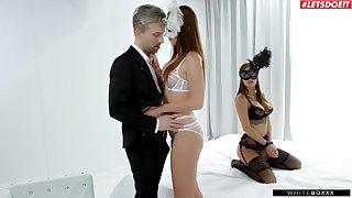 Masked beauties share romantic moments in threesome